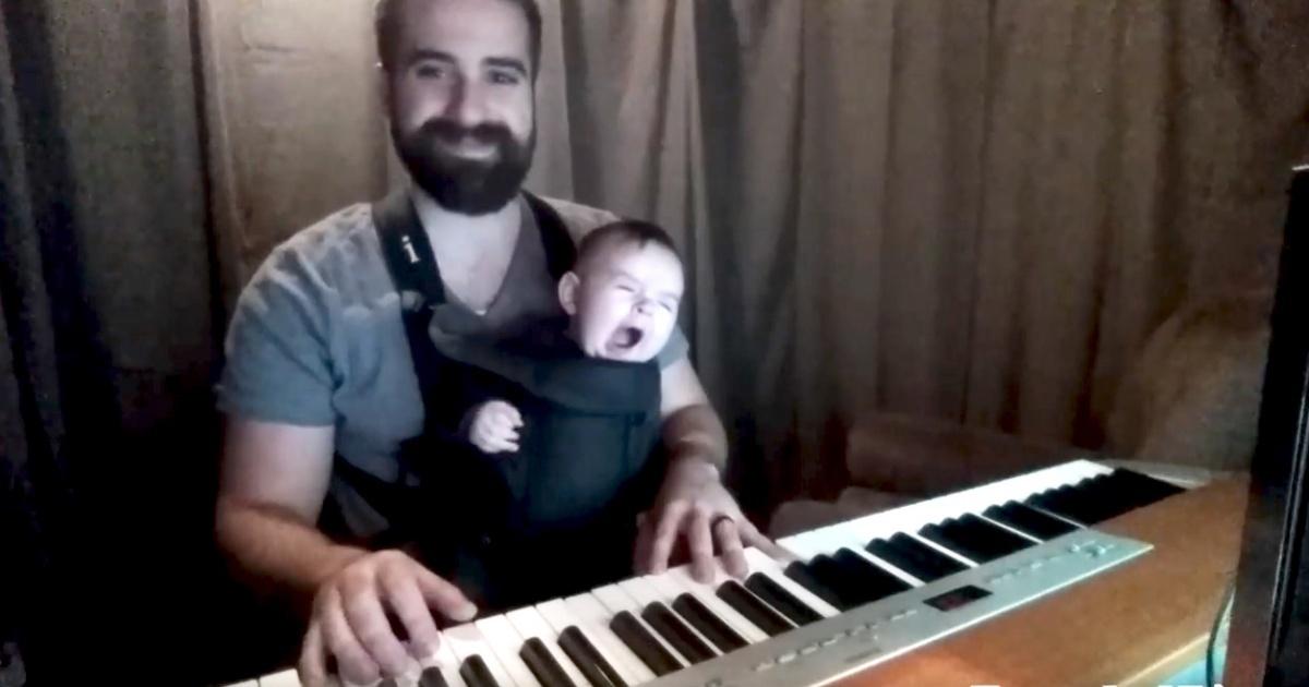 Заботливый папа укладывает ребенка спать